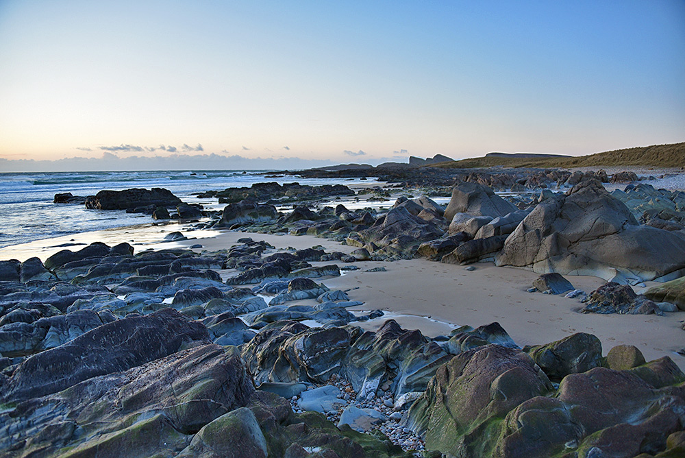 Picture of a view over a rocky shore, exposed after winter storms washed away most of the sand