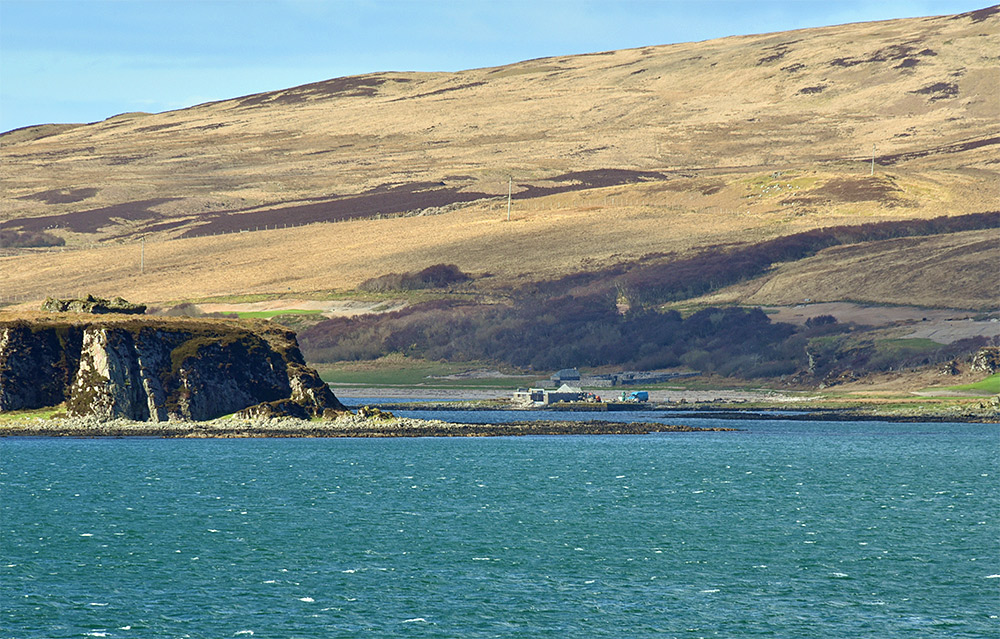 Picture showing a boathouse where work is being carried out, seen from a passing ferry