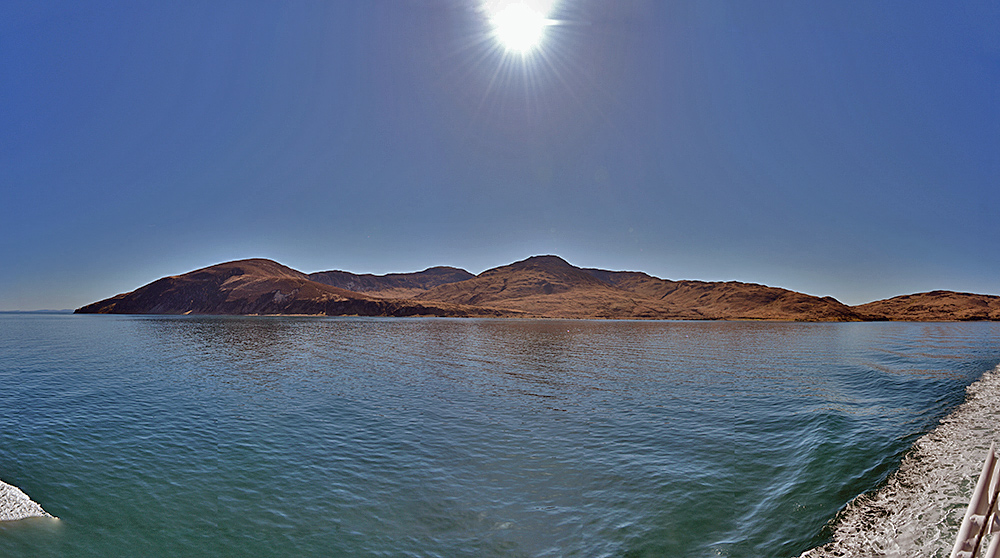 Panoramic picture of a coastline seen from a ferry on a bright sunny day