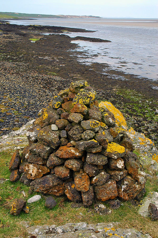 Picture of a small cairn on the shore of a sea loch