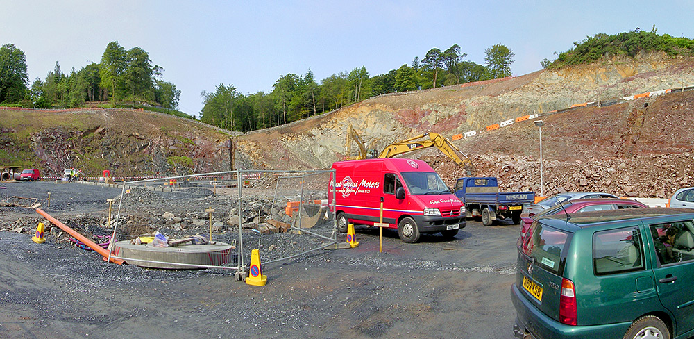 Picture of a very large construction area for a ferry waiting area cut into a hill