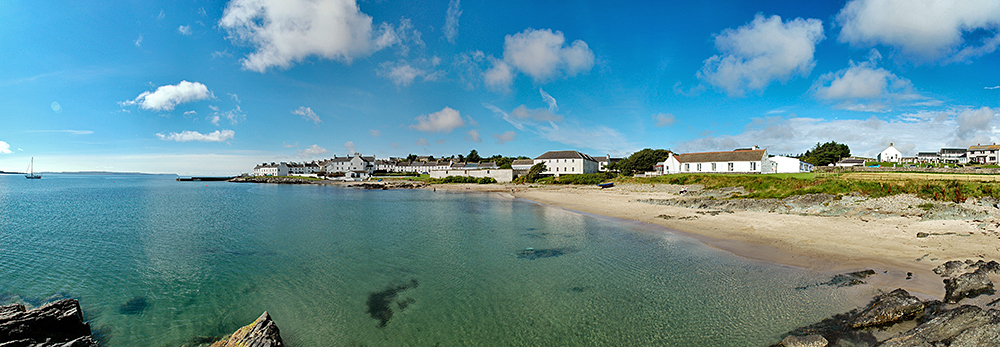 Panoramic picture of a coastal village with a small beach