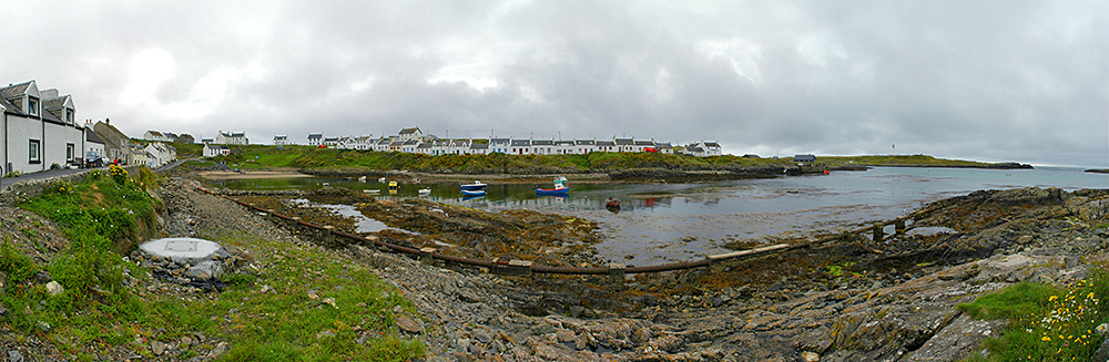 Panoramic picture of a coastal village around a small bay