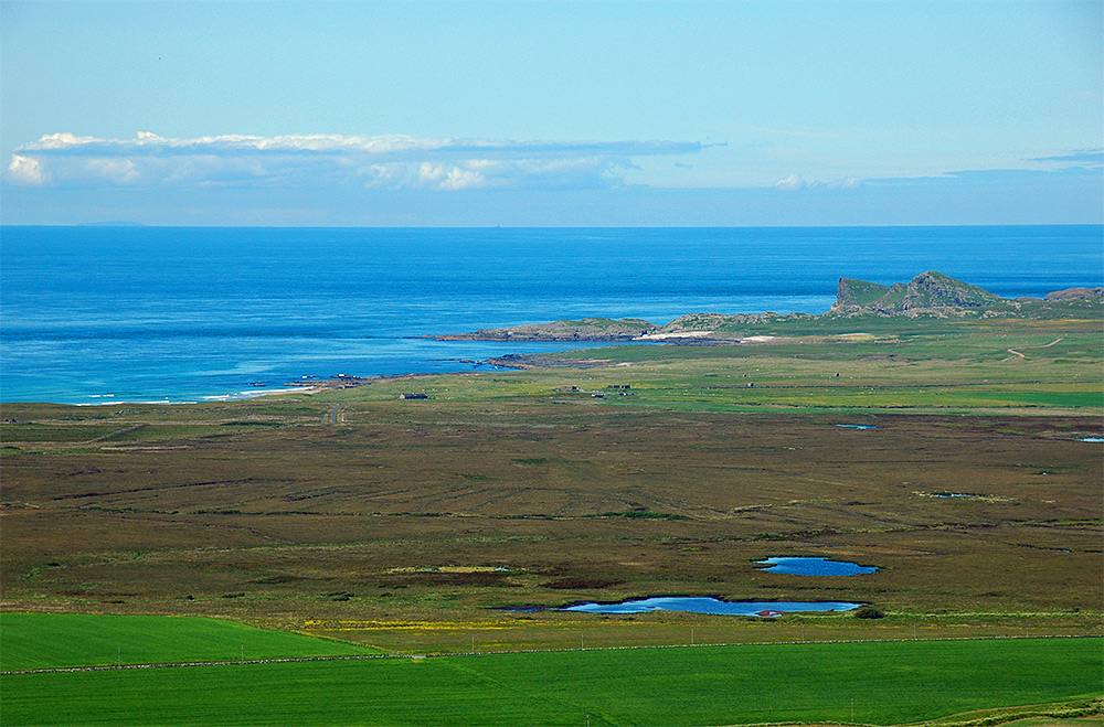 Picture of a coastal landscape seen from a hill