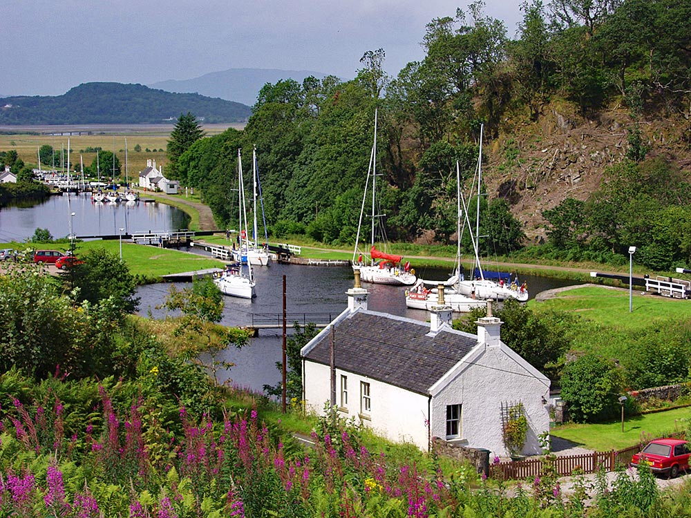 Picture of a view of a canal, many sailing yachts in basins and locks
