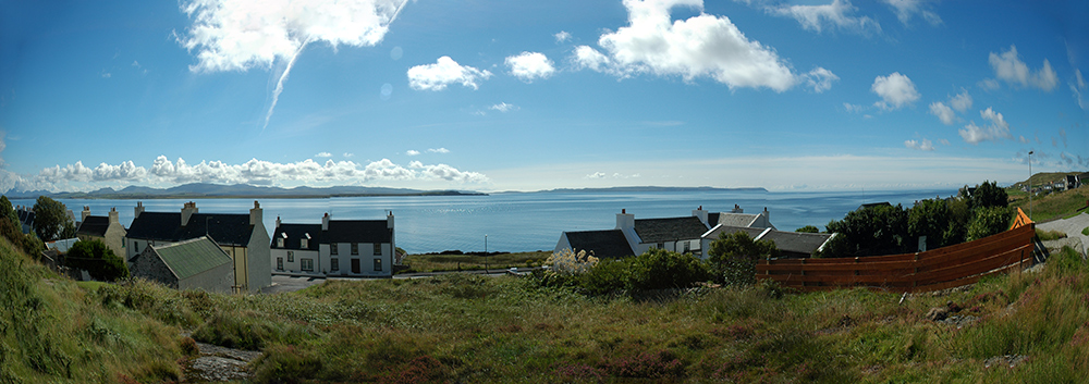 Panoramic picture of a view over a sea loch from a coastal village