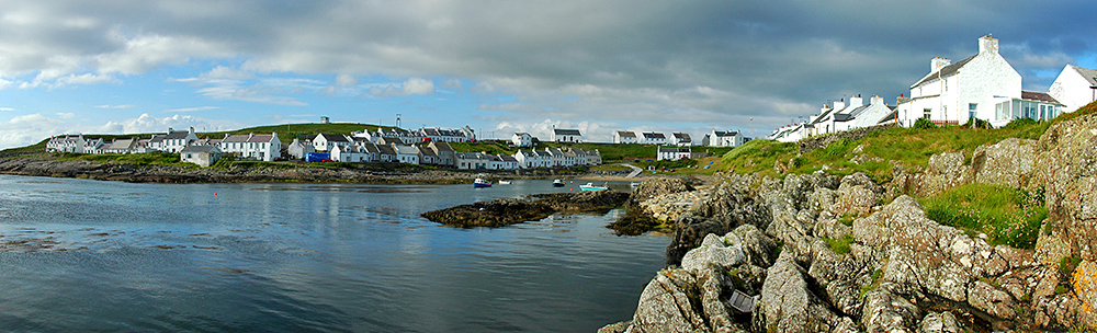 Panoramic picture of a small coastal village nestling around a bay
