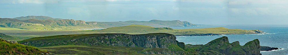 Panoramic picture of a rugged coast with bays and crags