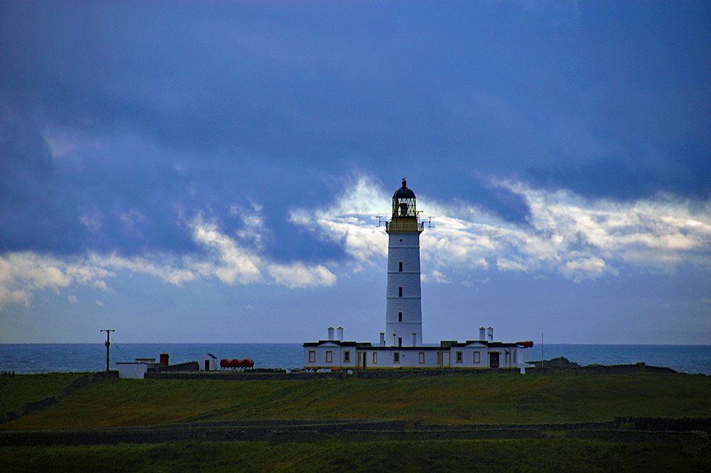 Picture of a lighthouse under dark clouds