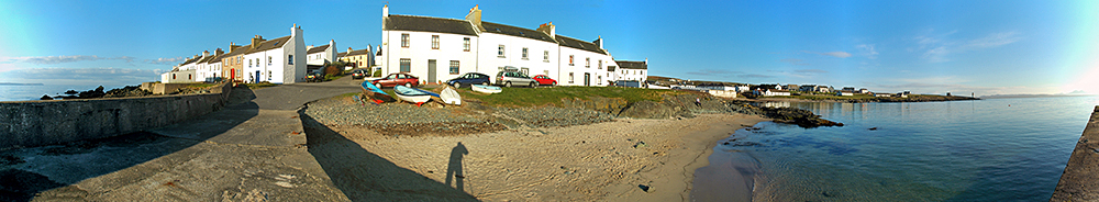 Panoramic picture of a coastal village seen from the village pier