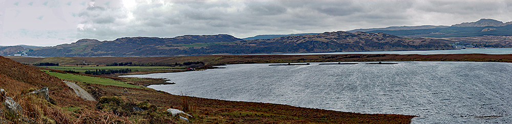 Panoramic picture of a view over a freshwater loch and a sound between two islands