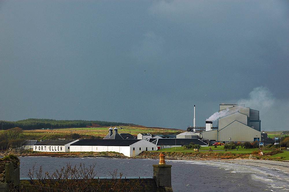 Picture of the former Port Ellen distillery and the modern maltings under a dark cloudy sky
