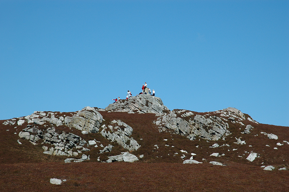 Picture of walkers on the summit of a hill