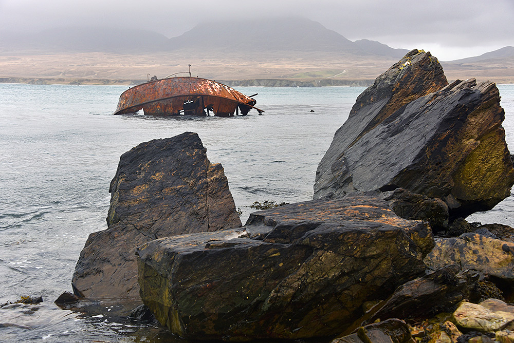 Picture of the remains of a wreck in a sound between two islands