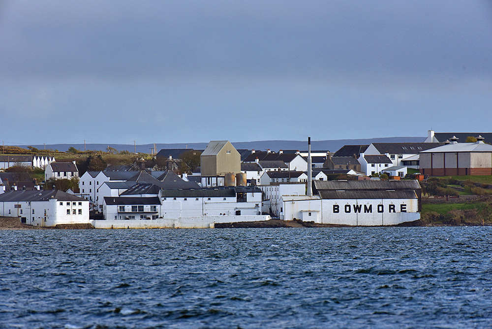 Picture of Bowmore distillery seen across Loch Indaal in the evening light