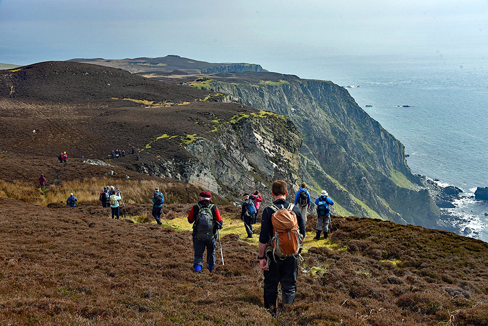 Picture of a group of hillwalkers walking along the edge of a high cliff