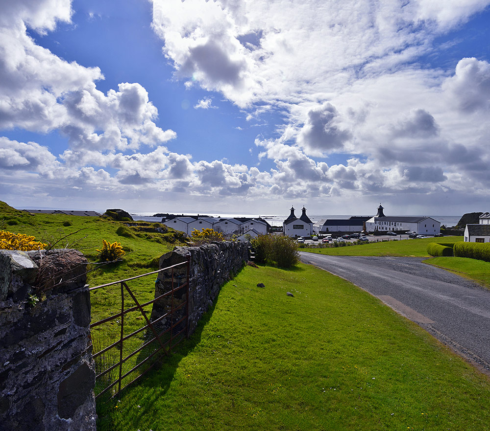 Panoramic picture of the approach to Ardbeg distillery on the south coast of Islay