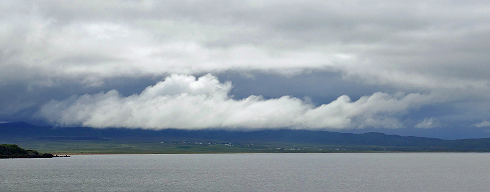 Picture of an interesting cloud formation over a wide bay