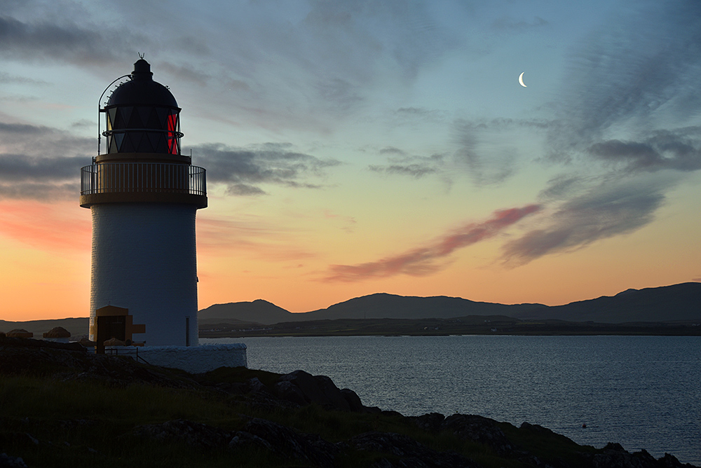 Picture of a small lighthouse during a June dawn