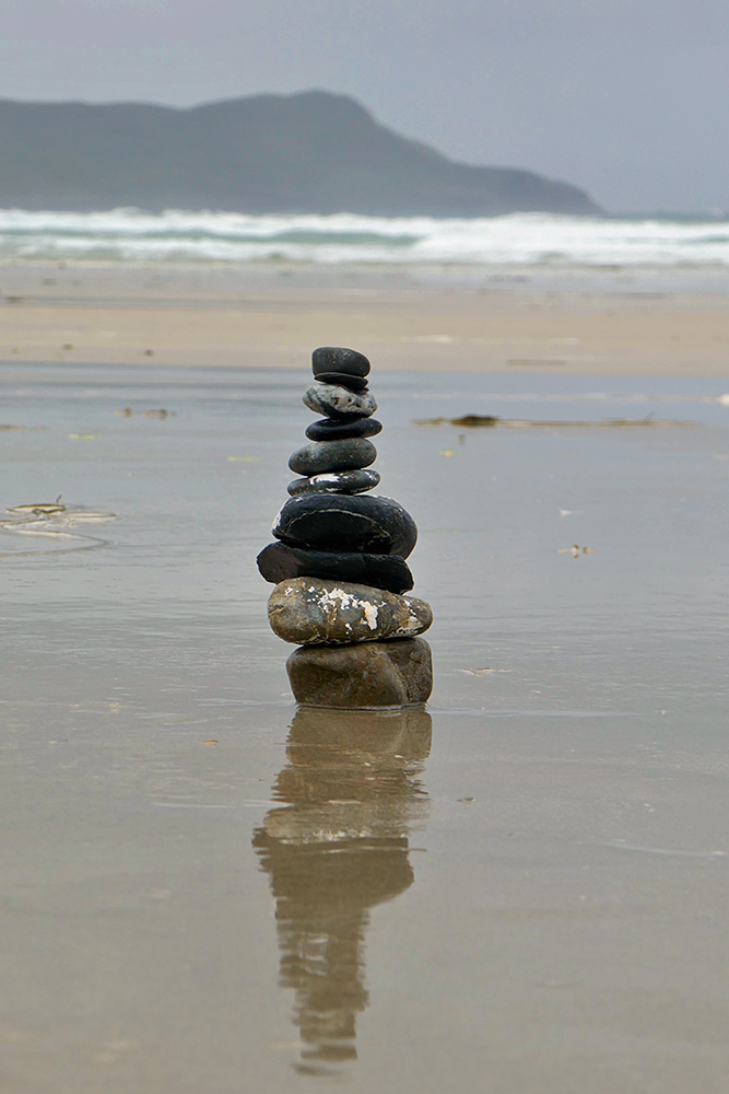 Picture of a small tower of balancing stones on a beach