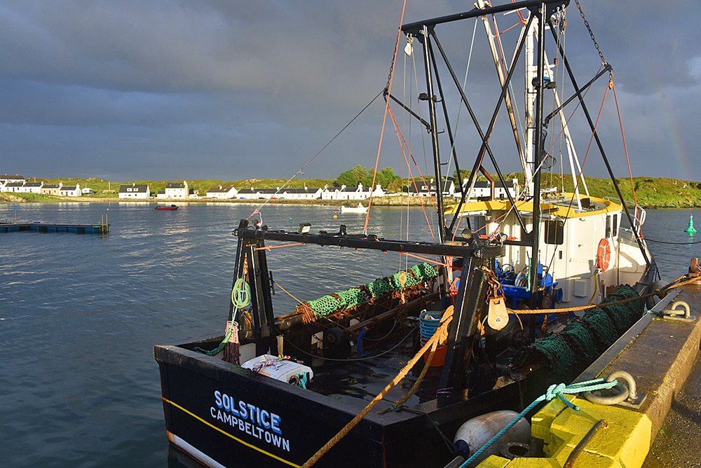 Picture of a fishing boat called Solstice at a pier in the evening sun
