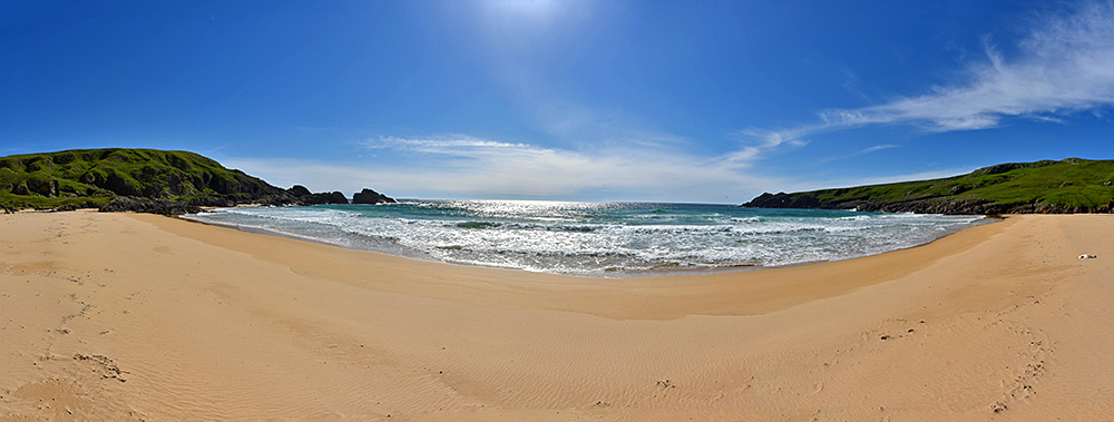 Panoramic picture of a golden sandy beach in a small bay