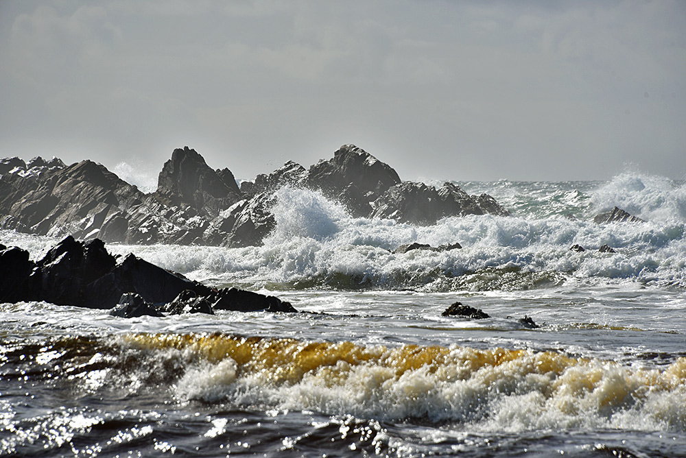 Picture of waves breaking around and over rocks