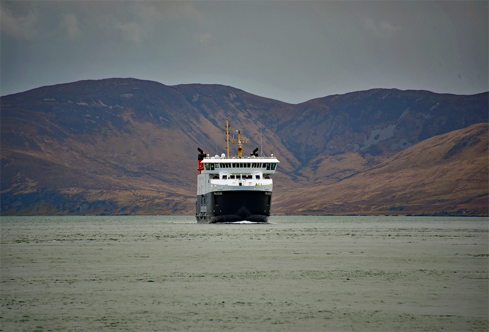 Picture of the Calmac ferry MV Finlaggan approaching in front of some hills