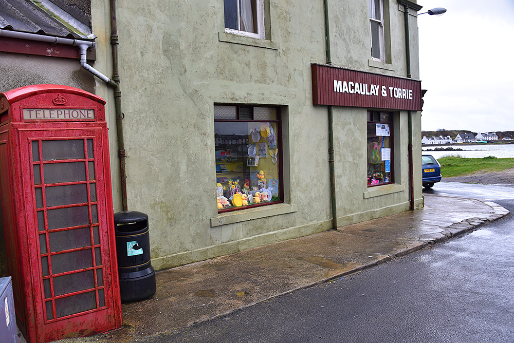 Picture of a red phone box next to the Macaulay and Torrie store