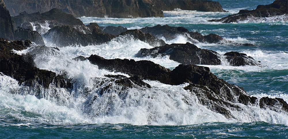 Picture of water running off rocks after a wave broke over them