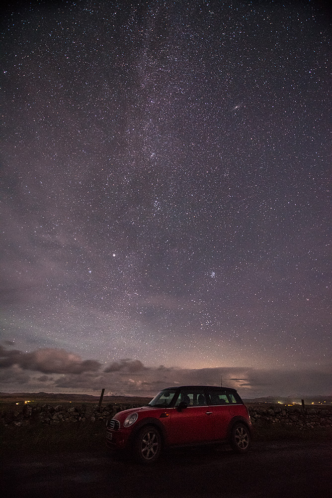 Picture of a Mini Clubman stopped on a country road under the Milky Way night sky