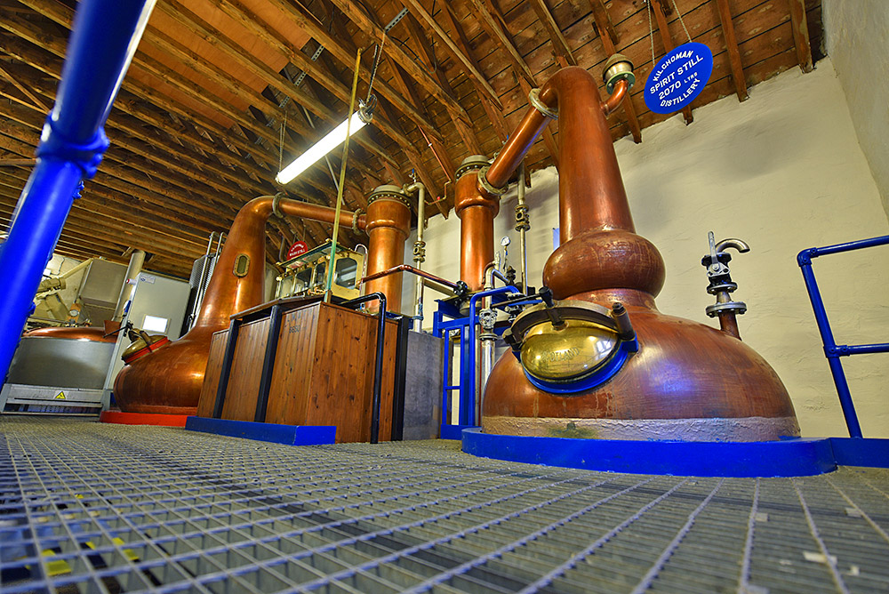 Picture of a view of the stills and spirit safe in the Kilchoman distillery still house