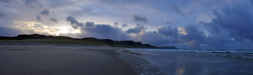 Panoramic picture of a wide beach in a bay on a November morning