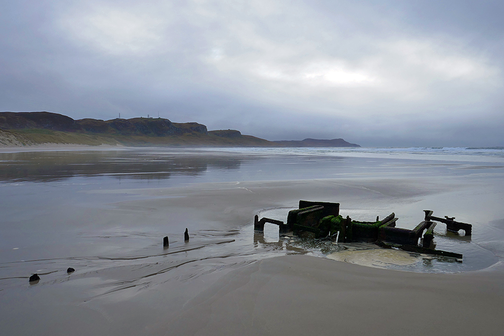 Picture of a wreck on a beach on a cloudy moody morning
