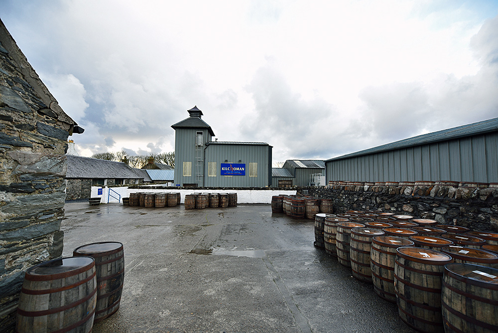 Picture of casks in the yard of a small farm whisky distillery