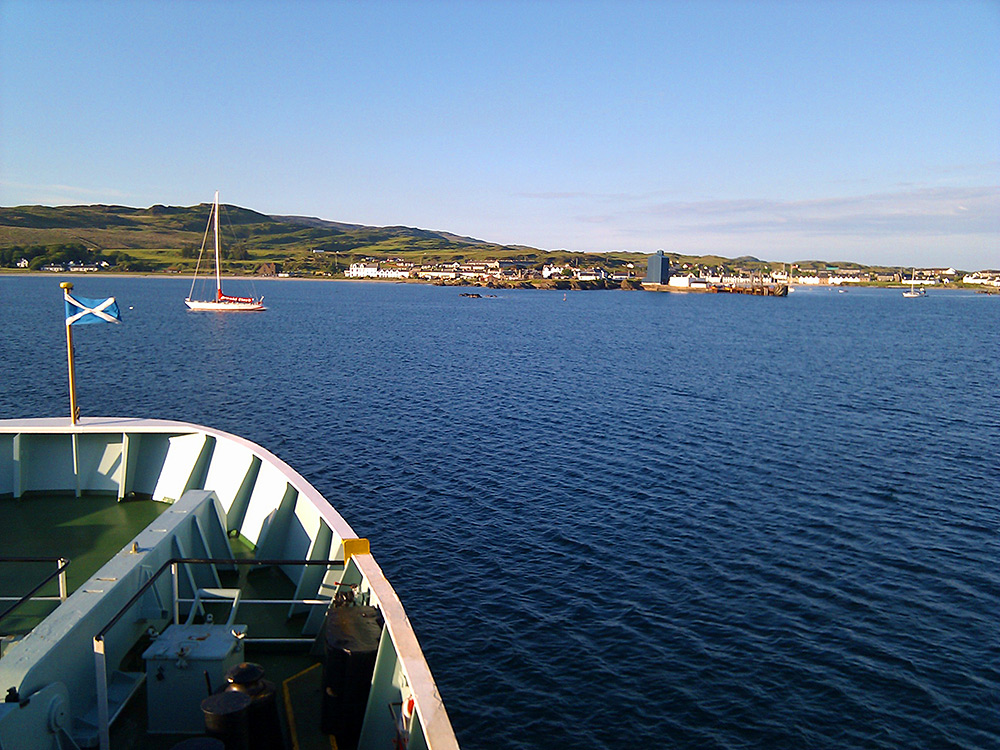 Picture of a view from a ferry arriving at a small port on a sunny day