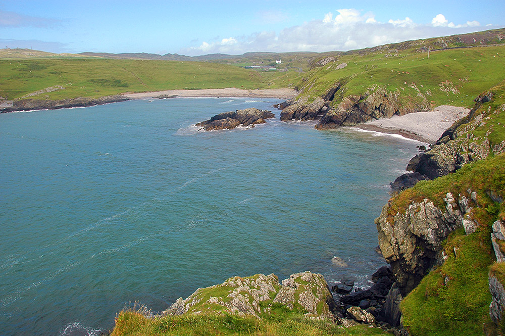 Picture of a bay with two stony beaches