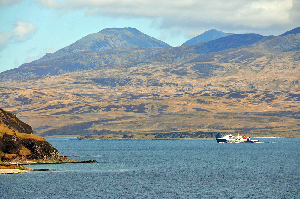 Picture of a Calmac ferry entering a sound between two islands