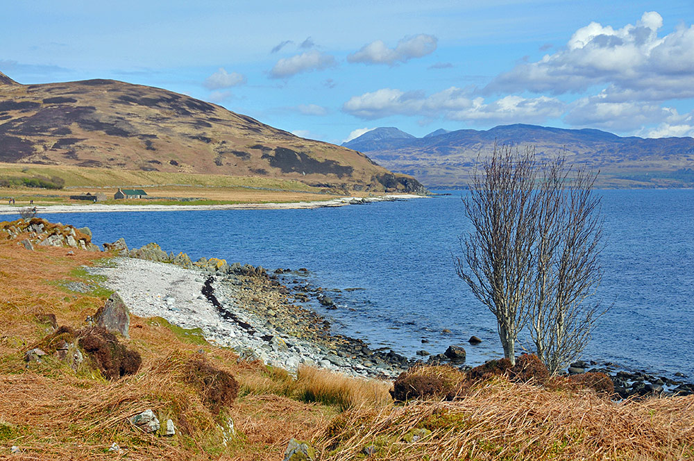 Picture of a view along a shore to a bothy