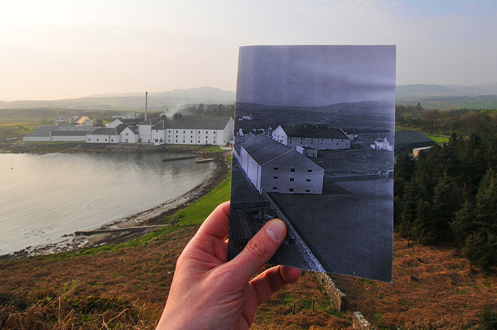 Picture of an old picture of a distillery held into a current picture, creating a window into the past