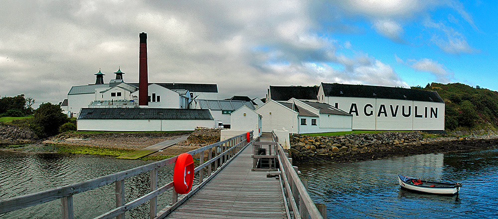 Panoramic picture of Lagavulin distillery seen from the pier as clouds move in