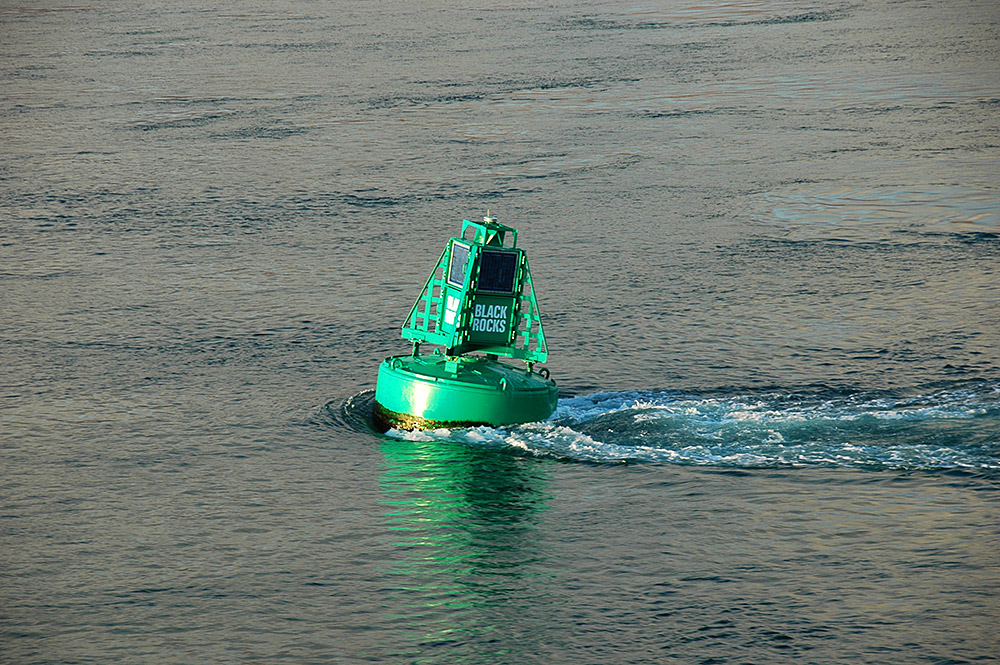 Picture of a buoy with a label Black Rocks in a tidal stream