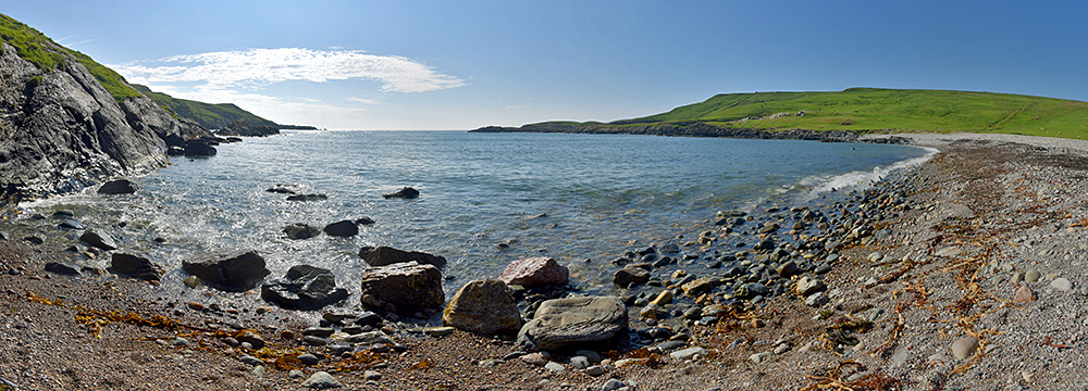 Panoramic view of a small bay with a pebble beach