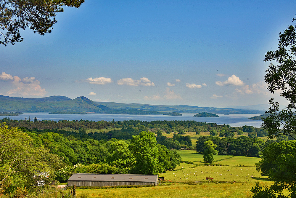 Picture of a view from a hill over a large loch (lake) with islands