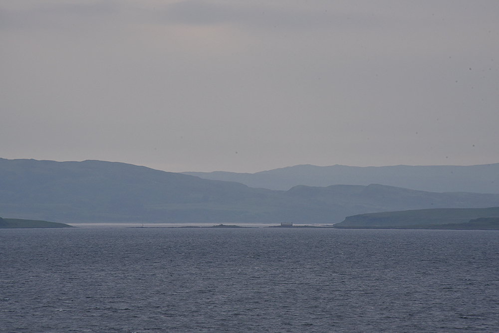 Picture of a view into a sound between two islands on an overcast summer evening