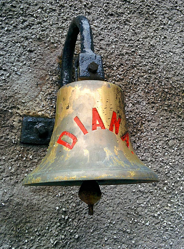 Picture of a bell with the name Diana written on it hanging on a wall