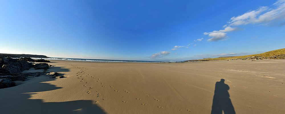 Panoramic wide angle picture of a sandy beach at low tide