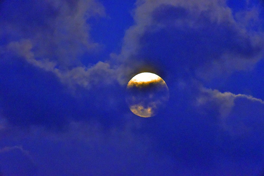 Picture of the Moon behind some clouds