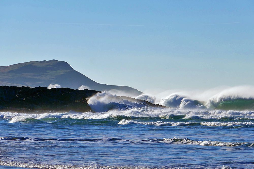 Picture of waves breaking near and over some rocks