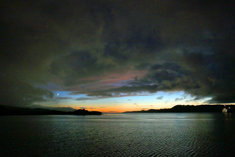 Picture of the last light over a sea loch on the west coast of Scotland, dramatic clouds overhead